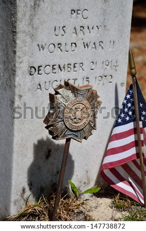 World War II Veteran's Resting Place Marked with American Flag - stock photo