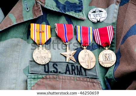 World War II veteran wearing his medals - stock photo