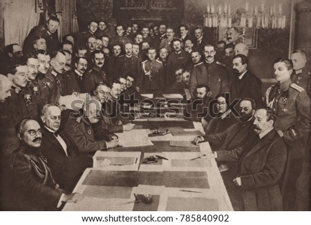 World War 1. The Bolshevik government of Russia signs a separate peace with Central Powers (Austria, Germany, Turkey) at Brest-Litovsk on March 3, 1918. Seated around the table, L-R: Zeki Pasha, couns