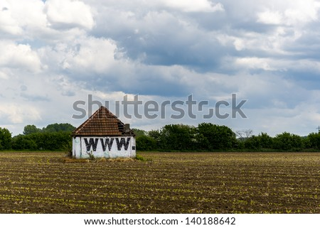 world wide web barn, in the middle of a field - stock photo
