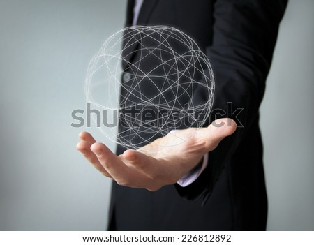 worldwide concept: spherical structure over businessman han - stock photo