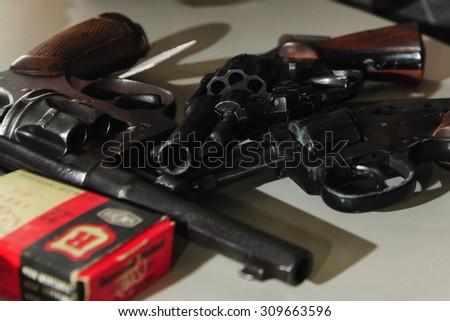 Worms, Germany - November 26, 2009 - Officer shows guns and ammunition confiscated during a raid - stock photo