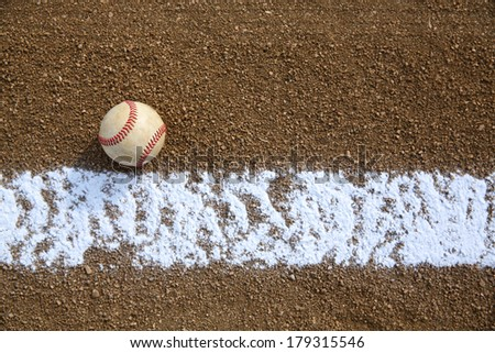 Worn Baseball near the Infield Chalk Line with room for copy - stock photo