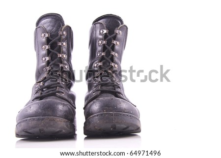worn black army boot isolated on white - stock photo