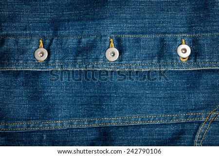 Worn blue crumpled denim jeans texture with some buttons - stock photo