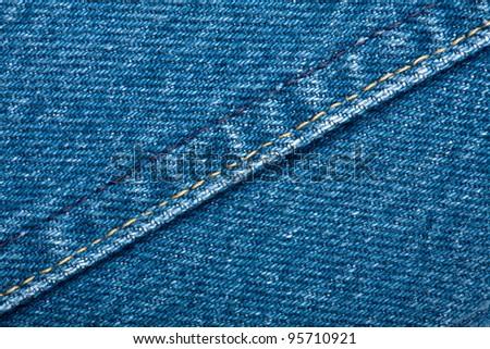Worn blue denim jeans texture with stitch - stock photo