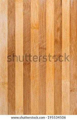 Worn butcher block cutting and chopping wooden board as background. Wood texture. - stock photo