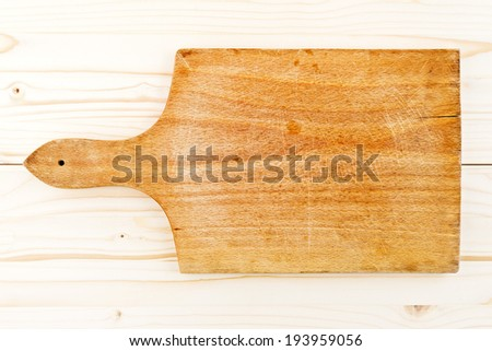 Worn butcher block cutting plate and chopping wooden board as background. Wood texture, top view - stock photo