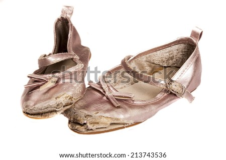 worn children's shoes. Image isolated on white background - stock photo