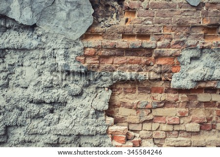 Worn cracked brick wall texture background. Vintage effect.   - stock photo