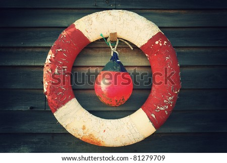 Worn down lifebuoy and flotation device awaiting their next use