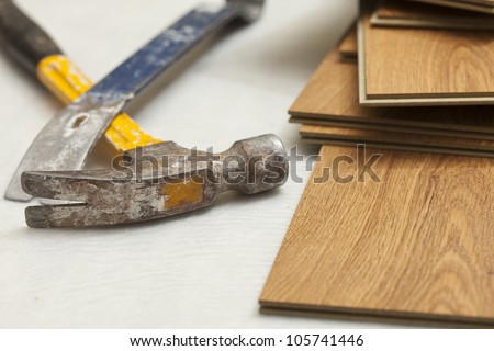 Worn Hammer and Pry Bar with Laminate Flooring Abstract. - stock photo