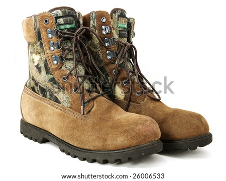 Worn hunting boots - stock photo