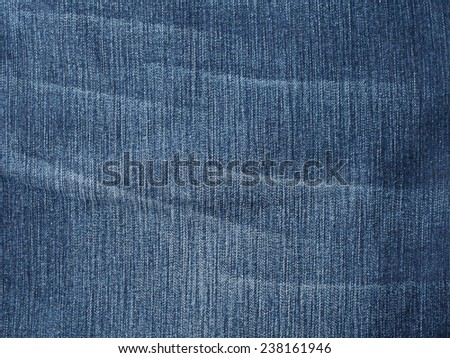 Worn jeans fabric plain surface background, blue denim textile texture - stock photo