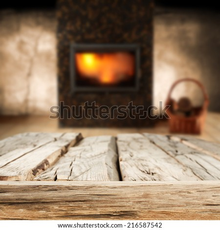 worn old table and fireplace