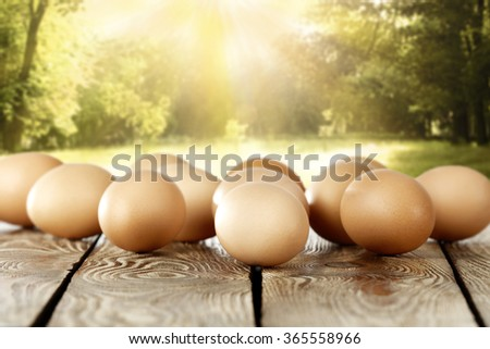 worn old table eggs and holiday time of easter  - stock photo