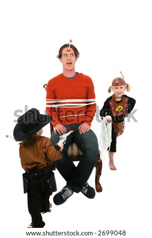 Worn out man playing cowboys and indians with young boy and girl - stock photo