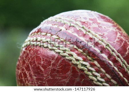 Worn out old cricket ball - stock photo