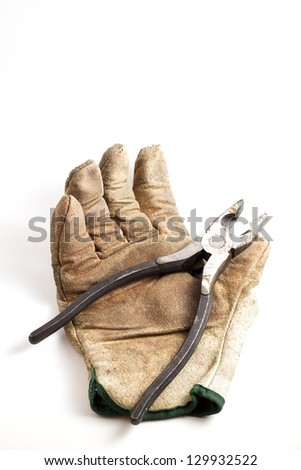 Worn out work glove and pliers. Add your text - stock photo