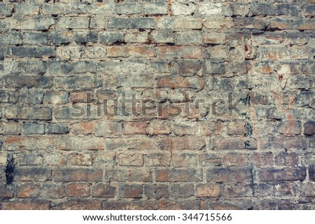Worn peeled brick wall. Vintage effect. - stock photo