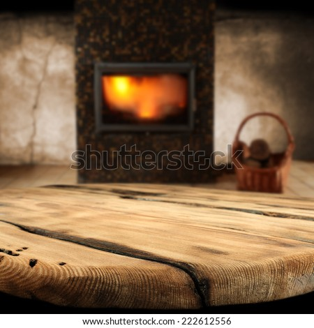 worn table and fireplace  - stock photo