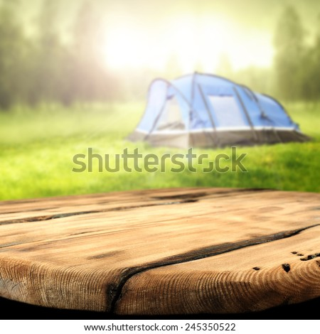 worn table and tent of blue  - stock photo