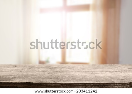 worn tabletop and window with day light  - stock photo