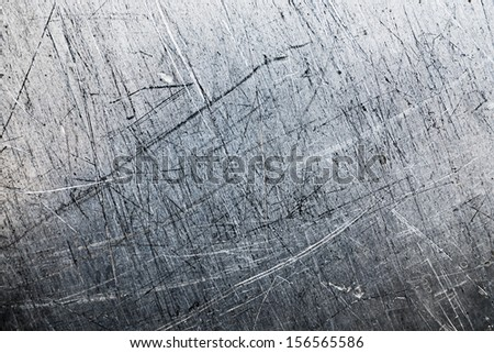 worn, textured metallic studio surface - stock photo