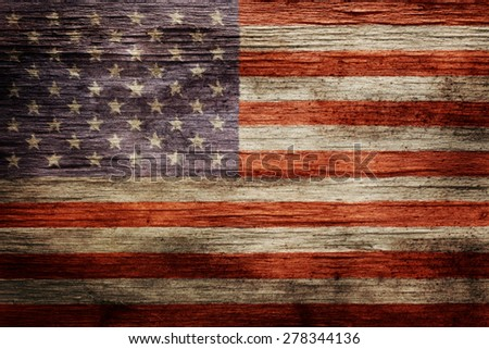 Worn vintage American flag background - stock photo