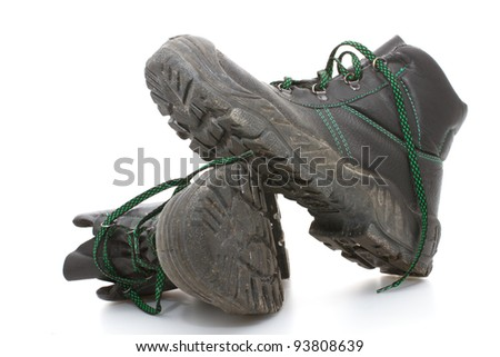 Worn work boots on a white background