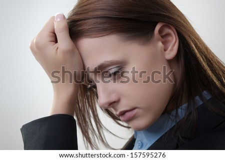Worried attractive businesswoman posing looking unhappy - stock photo