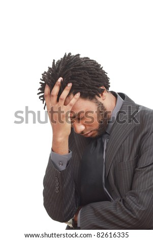 Worried black businessman - stock photo