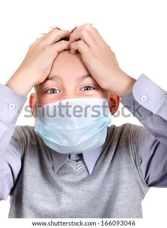Worried Boy in Flu Mask Isolated on the White Background - stock photo