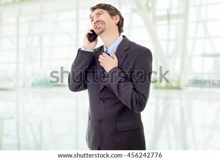 worried business man on the phone, at the office - stock photo