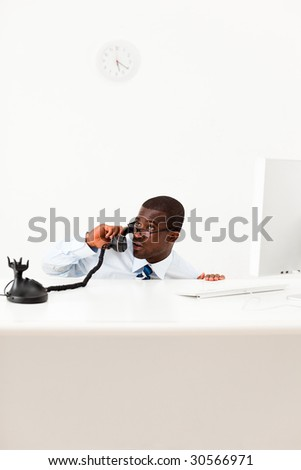 worried businessman hiding behind desk. Copy space - stock photo