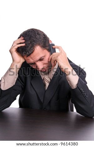 worried businessman on the phone - stock photo