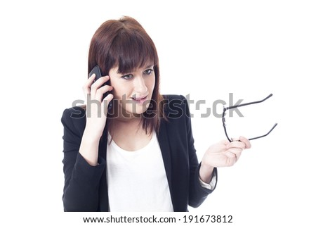 Worried businesswoman talking on the phone - stock photo
