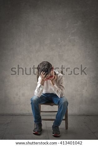 Worried child - stock photo