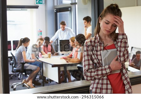 Worried Female Student Waiting Outside College Tutorial - stock photo