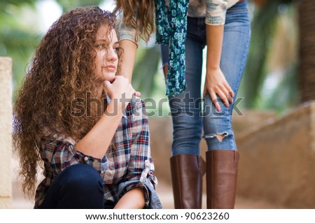 worried girl comforted by a friend - stock photo