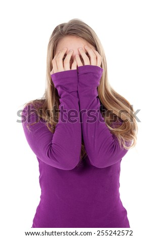 Worried girl covering her face isolated on a white background - stock photo