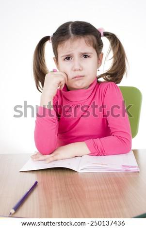 worried little student - stock photo