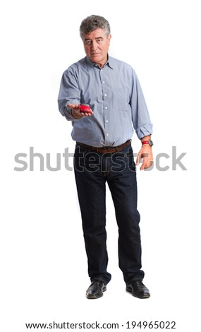 Worried man holding a toy car