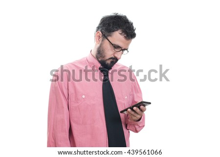 Worried man looking at his smart phone