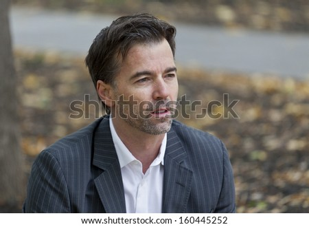 Worried Man Looking Away In The Park - stock photo