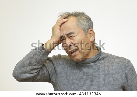 Worried mature man touching his head  (Mental health)