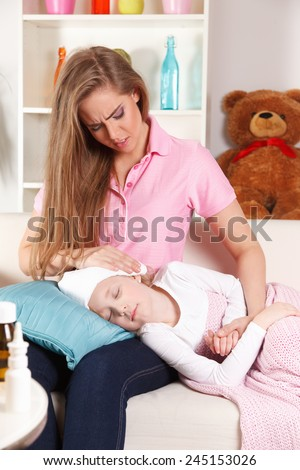 Worried mother with sick child - stock photo