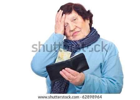 Worried pensioner holding a wallet with last  penny isolated on white background - stock photo