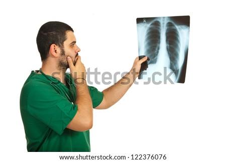 Worried radiologist man examine Xray isolated on white background - stock photo
