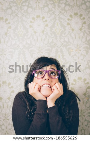 Worried woman looking up nervous and scared. Instagram retro filtered image. - stock photo